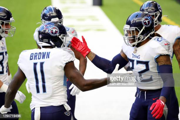 Derrick Henry and A.J. Brown of the Tennessee Titans in action against the Houston Texans during a game at NRG Stadium on January 03, 2021 in...