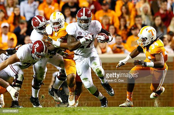 Derrick Henry of the Alabama Crimson Tide against Jalen Reeves-Maybin of the Tennessee Volunteers at Neyland Stadium on October 25, 2014 in...