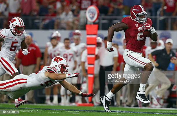 Derrick Henry of the Alabama Crimson Tide breaks away from Joe Schobert of the Wisconsin Badgers to score a touchdown in the third quarter during The...