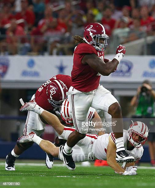 Derrick Henry of the Alabama Crimson Tide breaks away from Leo Musso of the Wisconsin Badgers to score a touchdown in the third quarter during The...