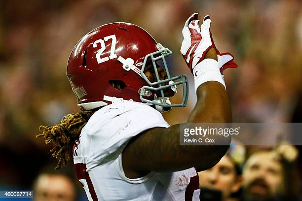 Derrick Henry of the Alabama Crimson Tide celebrates after rushing for a touchdown against the Missouri Tigers in the fourth quarter of the SEC...