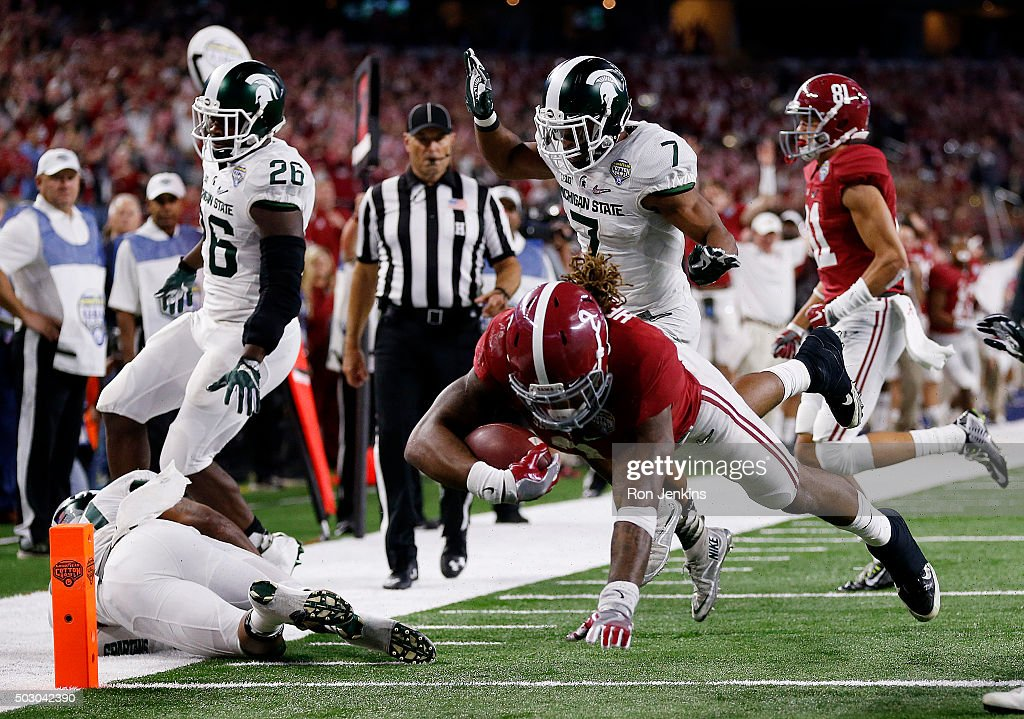 Derrick Henry #2 of the Alabama Crimson Tide dives for a touchdown in the fourth quarter against the Michigan State Spartans during the Goodyear Cotton Bowl at AT&T Stadium on December 31, 2015 in Arlington, Texas.