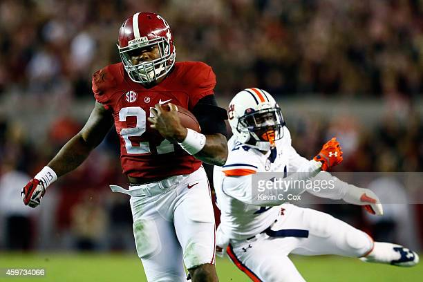 Derrick Henry of the Alabama Crimson Tide runs the ball in the fourth quarter against the Auburn Tigers during the Iron Bowl at BryantDenny Stadium...