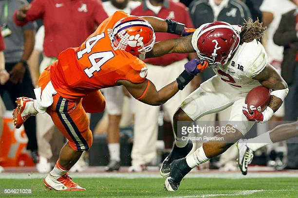 Derrick Henry of the Alabama Crimson Tide runs the ball in the second quarter against B.J. Goodson of the Clemson Tigers during the 2016 College...