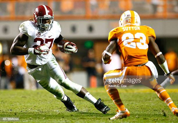 Derrick Henry of the Alabama Crimson Tide rushes against Cameron Sutton of the Tennessee Volunteers at Neyland Stadium on October 25 2014 in...