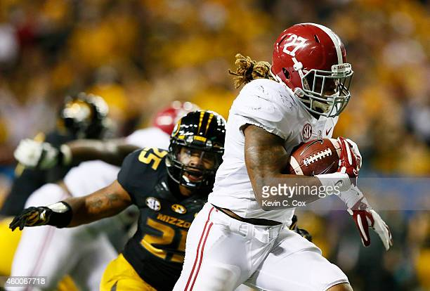 Derrick Henry of the Alabama Crimson Tide rushes for a touchdown against the Missouri Tigers in the fourth quarter of the SEC Championship game at...