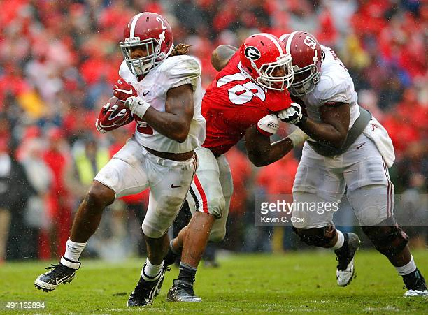 Derrick Henry of the Alabama Crimson Tide rushes for a touchdown against the Georgia Bulldogs at Sanford Stadium on October 3, 2015 in Athens,...