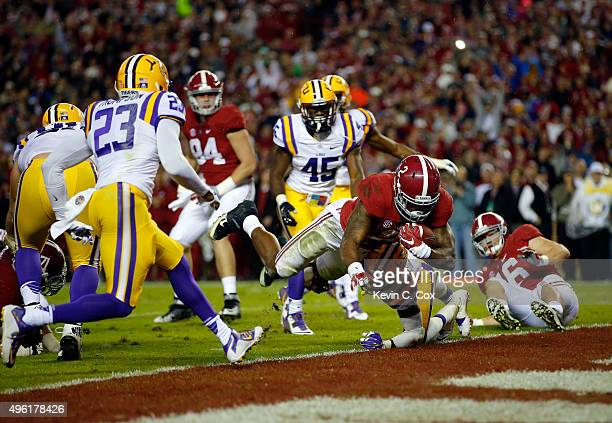 Derrick Henry of the Alabama Crimson Tide rushes for touchdown against Jalen Mills of the LSU Tigers in the second quarter at BryantDenny Stadium on...