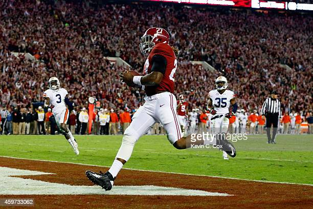 Derrick Henry of the Alabama Crimson Tide scores a 25 yard touchdown in the fourth quarter against the Auburn Tigers during the Iron Bowl at...