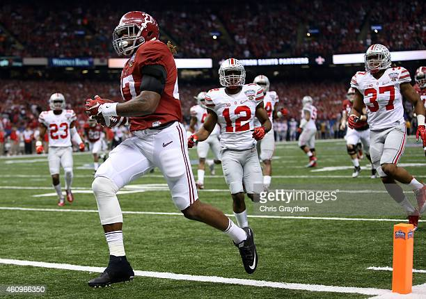 Derrick Henry of the Alabama Crimson Tide scores a 25 yard touchdown in the first quarter against the Ohio State Buckeyes during the All State Sugar...