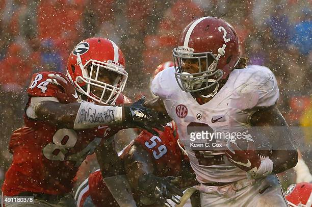 Derrick Henry of the Alabama Crimson Tide tries to break a tackle by Leonard Floyd of the Georgia Bulldogs at Sanford Stadium on October 3, 2015 in...