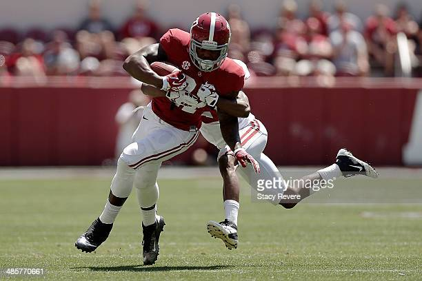 Derrick Henry of the Crimson team is brought down by Bradley Sylve of the White team during the University of Alabama ADay spring game at BryantDenny...