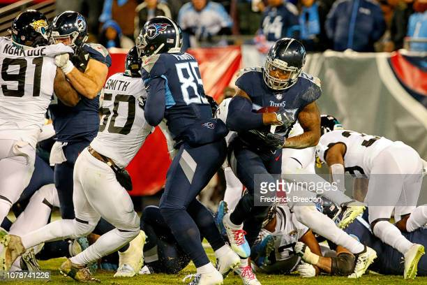 Derrick Henry of the Tennessee Titans breaks through the line to rush for a 99 yard touchdown against the Jacksonville Jaguars at Nissan Stadium on...