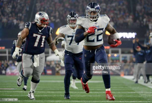 Derrick Henry of the Tennessee Titans carries the ball against Danny Shelton of the New England Patriots in the second quarter of the AFC Wild Card...