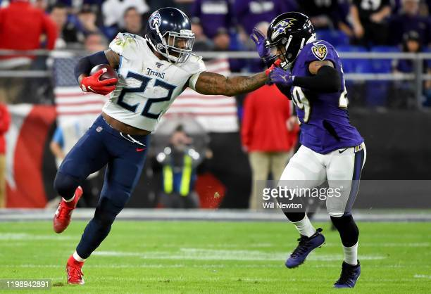 Derrick Henry of the Tennessee Titans carries the ball against Earl Thomas of the Baltimore Ravens during the AFC Divisional Playoff game at M&T Bank...