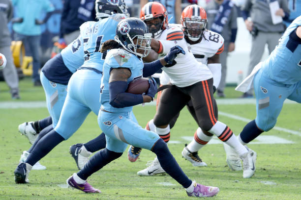 Derrick Henry of the Tennessee Titans carries the ball against the Cleveland Browns in the third quarter at Nissan Stadium on December 06, 2020 in...