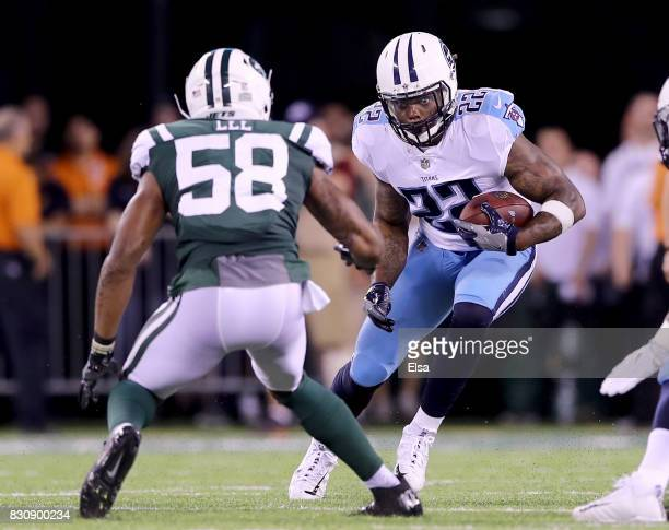 Derrick Henry of the Tennessee Titans carries the ball as Darron Lee of the New York Jets defends in the first quarter during a preseason game at...