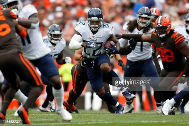 Derrick Henry of the Tennessee Titans carries the ball during the fourth quarter of the game against the Cleveland Browns at FirstEnergy Stadium on...