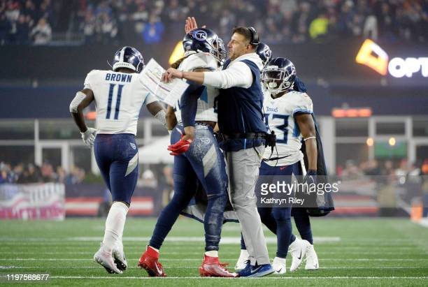Derrick Henry of the Tennessee Titans celebrates his touchdown with head coach Mike Vrabel against the New England Patriots in the second quarter of...