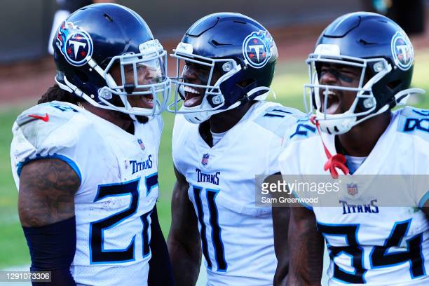 Derrick Henry of the Tennessee Titans celebrates with A.J. Brown and Corey Davis after scoring a touchdown against the Jacksonville Jaguars in the...