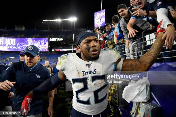 Derrick Henry of the Tennessee Titans celebrates with fans after defeating the Baltimore Ravens in the AFC Divisional Playoff game at M&T Bank...