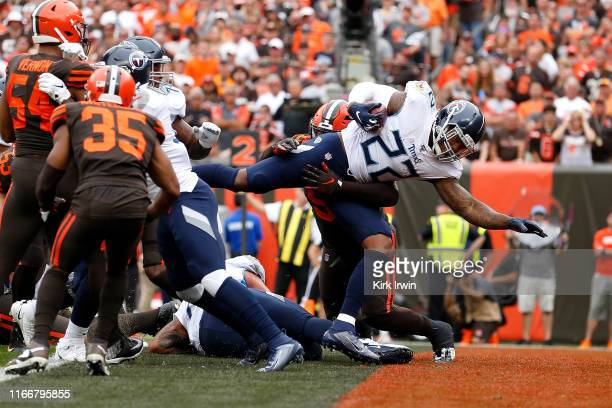Derrick Henry of the Tennessee Titans dives into the endzone for a touchdown during the second quarter of the game against the Cleveland Browns at...