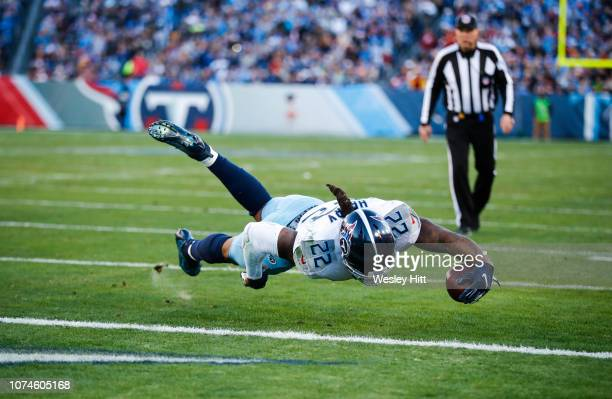 Derrick Henry of the Tennessee Titans dives to score a touchdown against the Washington Redskins during the first quarter at Nissan Stadium on...