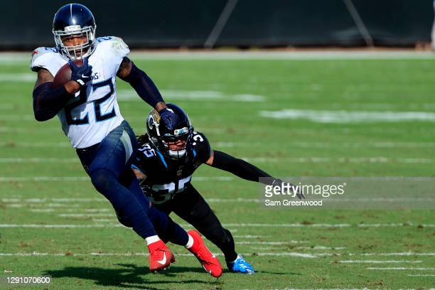 Derrick Henry of the Tennessee Titans evades a tackle from Sidney Jones of the Jacksonville Jaguars to the run for a touchdown in the second quarter...