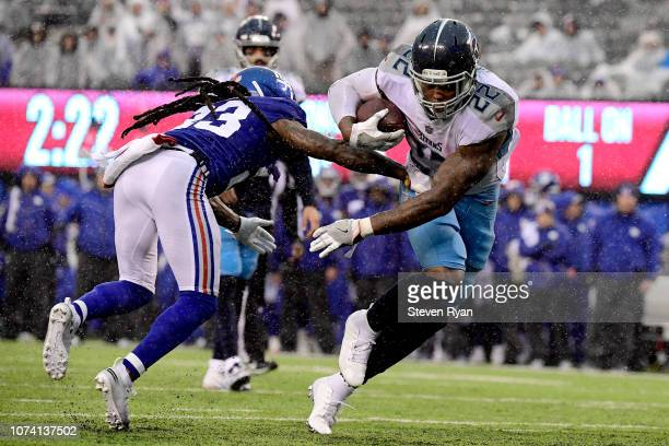 Derrick Henry of the Tennessee Titans gets past BW Webb of the New York Giants on his way to a second half touchdown at MetLife Stadium on December...