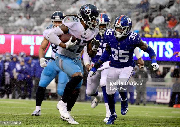 Derrick Henry of the Tennessee Titans gets past Curtis Riley of the New York Giants on his way to a second half touchdown at MetLife Stadium on...