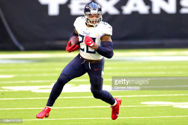 Derrick Henry of the Tennessee Titans in action against the Houston Texans during a game at NRG Stadium on January 03, 2021 in Houston, Texas.