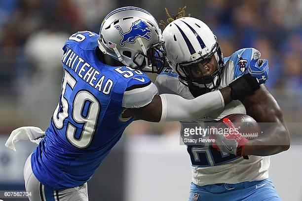 Derrick Henry of the Tennessee Titans is brought down by Tahir Whitehead of the Detroit Lions during the second half of a game at Ford Field on...