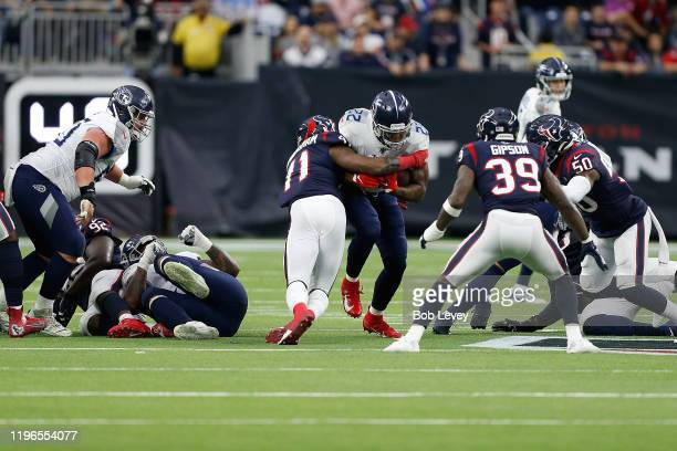 Derrick Henry of the Tennessee Titans is brought down by Zach Cunningham of the Houston Texans during the first half at NRG Stadium on December 29,...