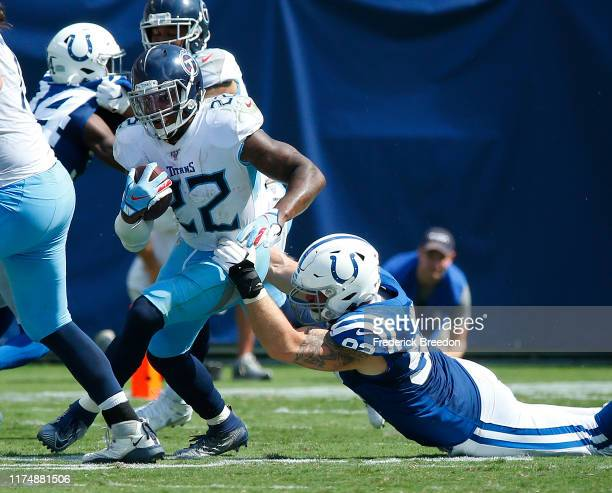 Derrick Henry of the Tennessee Titans is grabbed by Margus Hunt of the Indianapolis Colts during the second half at Nissan Stadium on September 15,...