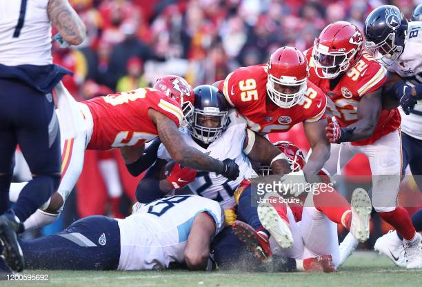 Derrick Henry of the Tennessee Titans is tackled by Chris Jones of the Kansas City Chiefs in the first half in the AFC Championship Game at Arrowhead...