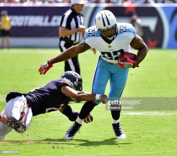 Derrick Henry of the Tennessee Titans is tackled by Quintin Demps of the Chicago Bears during the first half at Nissan Stadium on August 27, 2017 in...