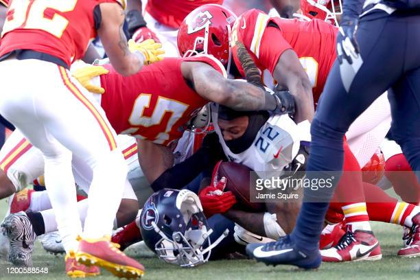 Derrick Henry of the Tennessee Titans loses his helmet as he's tackled in the first half by Anthony Hitchens of the Kansas City Chiefs in the AFC...