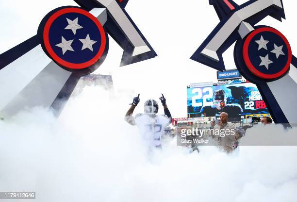 Derrick Henry of the Tennessee Titans points up while walking onto the field before the game against the Buffalo Bills at Nissan Stadium on October...