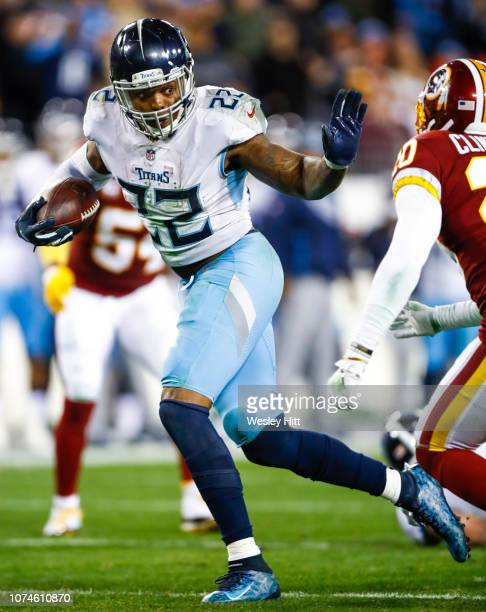 Derrick Henry of the Tennessee Titans prepares to block Ha Ha ClintonDix of the Washington Redskins while running with the ball during the fourth...