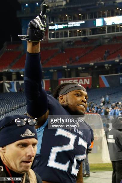 Derrick Henry of the Tennessee Titans raises a finger as leaves the field after rushing for a career high 238 yards and four touchdowns against the...