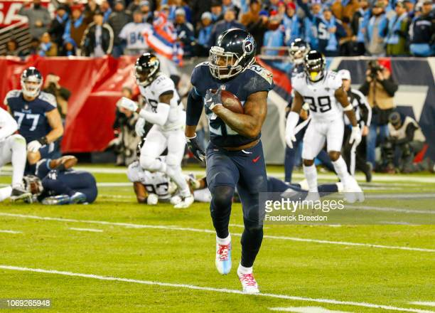 Derrick Henry of the Tennessee Titans runs downfield with the ball for a 99 yard touchdown against the Jacksonville Jaguars at Nissan Stadium on...