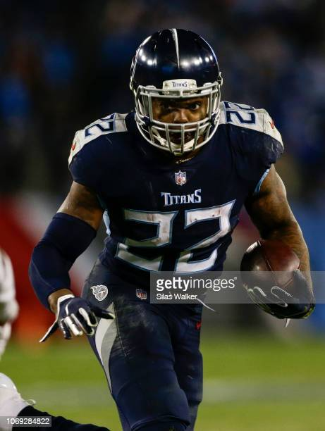 Derrick Henry of the Tennessee Titans runs downfield with the ball against the Jacksonville Jaguars during the fourth quarter at Nissan Stadium on...
