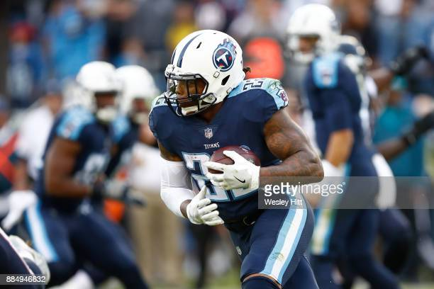 Derrick Henry of the Tennessee Titans runs for a touchdown against the Houston Texans during the second half at Nissan Stadium on December 3 2017 in...