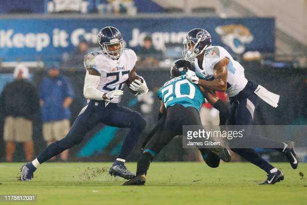 Derrick Henry of the Tennessee Titans runs for yardage during the second quarter against the Jacksonville Jaguars at TIAA Bank Field on September 19...