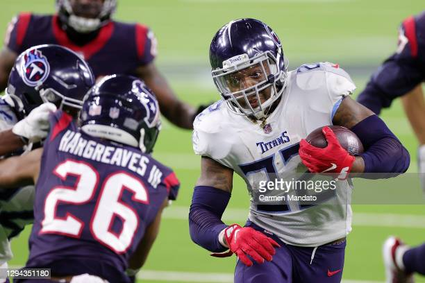 Derrick Henry of the Tennessee Titans runs for yards during the second half of a game against the Houston Texans at NRG Stadium on January 03, 2021...
