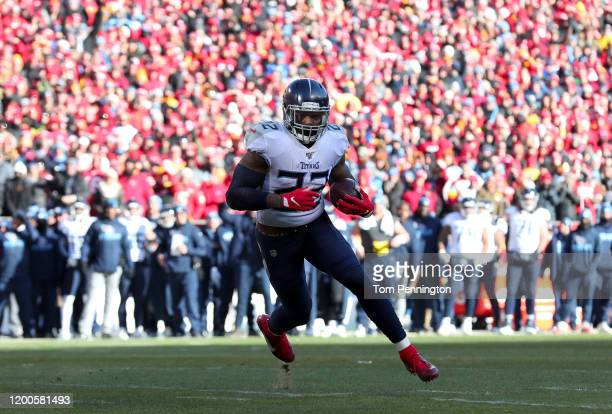 Derrick Henry of the Tennessee Titans runs in a 4 yard touchdown in the first quarter against the Kansas City Chiefs in the AFC Championship Game at...
