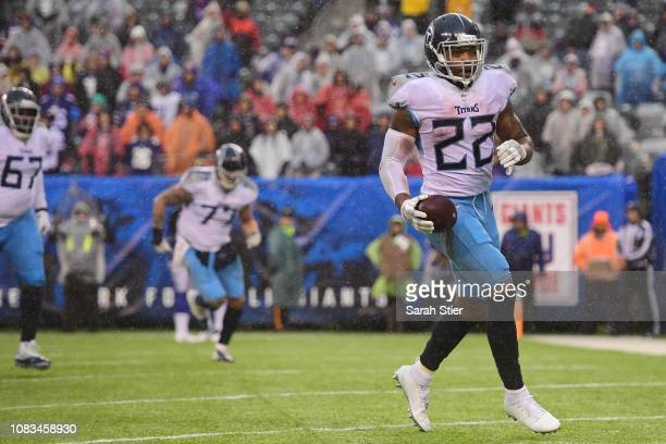 Derrick Henry of the Tennessee Titans runs into the end zone to score a touchdown during the third quarter of the game against the New York Giants at...
