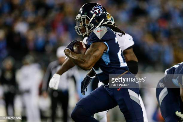 Derrick Henry of the Tennessee Titans runs past the Jacksonville Jaguars defense during the first quarter at Nissan Stadium on December 6 2018 in...