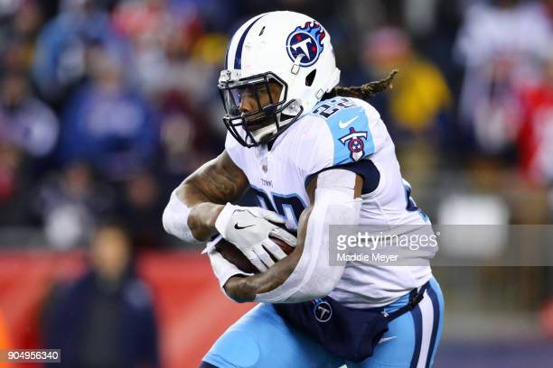 Derrick Henry of the Tennessee Titans runs the ball against the New England Patriots during the AFC Divisional Playoff game at Gillette Stadium on...
