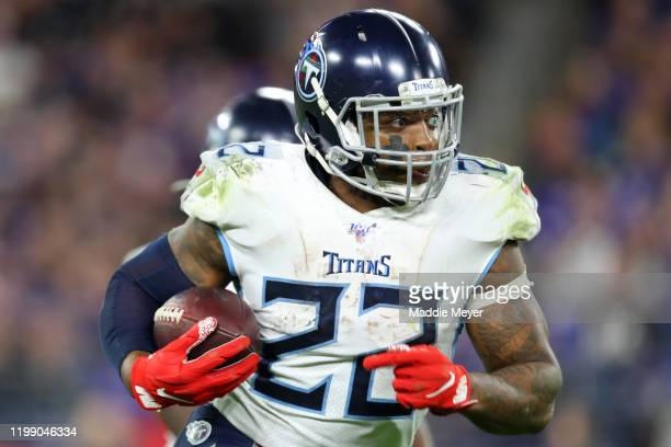 Derrick Henry of the Tennessee Titans runs the ball against the Baltimore Ravens during the AFC Divisional Playoff game at M&T Bank Stadium on...